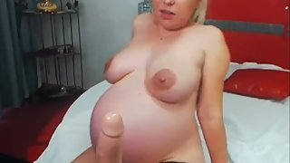 HUGE PREGNANT BELLY big ass and big tits MILF smoking
