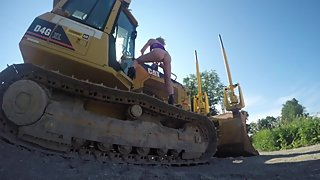 PUBLIC NUDITY PLAYING OUTSIDE ON THE HEAVY EQUIPMENT NEAR HIGHWAY