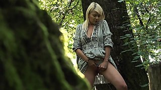 Pissing milf followed by voyeur in the forest